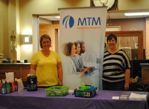 MTM, Inc.'s Christina Meyer and Melissa Workman attend the Bad River Health Fair July 17