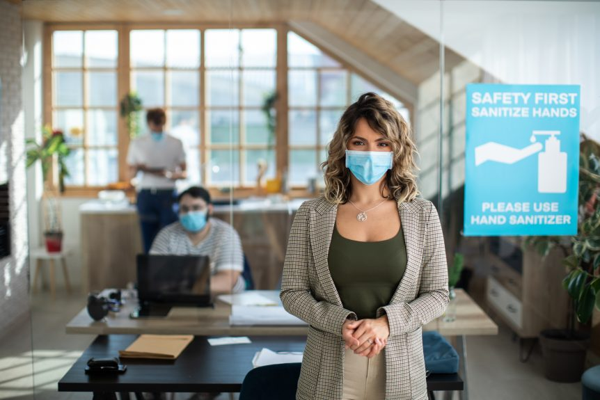 A woman stands in a work office wearing a face covering. MTM takes the health and safety of our teammates and visitors seriously. To prevent the spread of COVID-19 and ensure our employees and visitors remain healthy, we have adopted strict COVID-19 protocol at our headquarters.